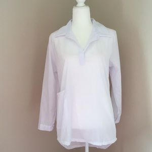 Very sheer long white sleeved blouse with pocket